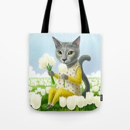 A cat sitting in the flower garden Tote Bag