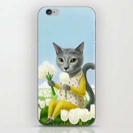 A cat sitting in the flower garden iPhone Skin