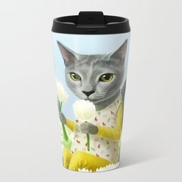 A cat sitting in the flower garden Metal Travel Mug