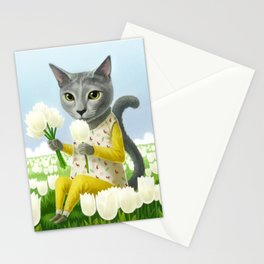 A cat sitting in the flower garden Stationery Cards
