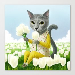 A cat sitting in the flower garden Canvas Print